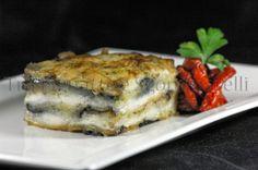 Parmigiana di pesce sciabola, con guarnizione di pomodoro disidratato