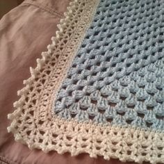 This is a baby blanket, I was just winging the edging....and it came out so pretty. I am in love with this.     Thought I should share t...