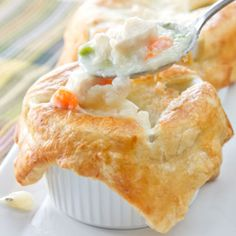 Individual Chicken Potpies: Puff pastry is used to top and envelope the brothy chicken goodness below on these individual servings potpies.