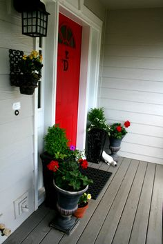 curb appeal - front porch red door | TodaysCreativeBlog.net  Color is Sherwin Williams- Positive Red.  House colors- Mindful grey and Gauntlet Grey