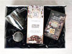 Safari Gift Box available from www.lilou.co.za   Lilou Online Gift Shopping   African Delight loose-leaf tea, marula jelly coated in chocolate, double-walled glass mug and tea strainer