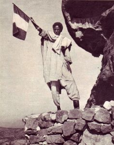 An Ethiopian greets the Italian troops entering Addis Ababa, He was one of the 800 Ethiopian soldiers who were taken prisoner in the battle of Adwa , and whose left foot and right hand were cut off as punishment for siding with the Italians. Black African American, African American History, Oriental, All About Africa, Rare Historical Photos, Haile Selassie, Italian Army, National History, Addis Ababa