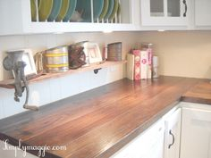 LOVE these wood countertops. they said they made them themselves and saves some money. must check back when they blog about it.