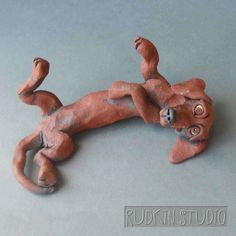 Dachshund Dog Lying on Back Ceramic Sculpture by RudkinStudio