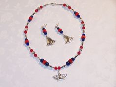 Egyptian-themed necklace with lapis, coral, silver, Isis pendant. Matching earrings with lotus flowers on SS posts.