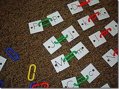 Using chain links to attach matching cards :) Great fine motor to go along with letter recognition!