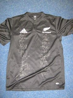 Signed All Black jersey 2010 Tri-Nations squad. One of the last without the sponsors on the front. ALL proceeds from the auction go to the Players Fund.