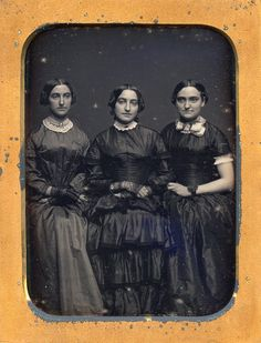 Arresting 1/4 plate daguerreotype of three dark-eyed sisters dressed in satin gowns. Description from jcosmas.com. I searched for this on bing.com/images