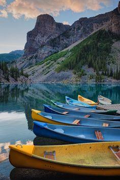 Canoes At Lake Moraine - Lake Moraine in Banff National Park, Canada.