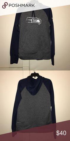 Nike Seahawks Hoodie Navy Blue and dark grey Seahawks hoodie. Nike Therma-Fit. Nike Tops Sweatshirts & Hoodies