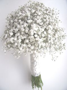 I love gypsophila. It is possibly one of my favourite flowers and is super cheap. How about bouquets of this for your little ones, with some added extras in your own bouquet. Personally, I'd happily have this all to myself. Beautiful. And it won't distract from your dress either.