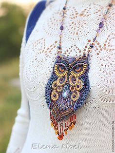 New fabulous owl with intelligent eyes and a penetrating gaze. Owl - pendant embroidered with Japanese beads, beautiful amethyst and amber.
