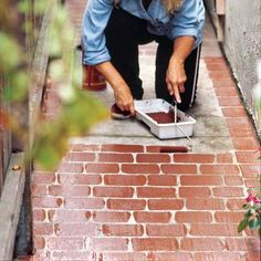Roll on Faux Bricks - instead of repaving give walkway or driveway a face-lift with paint. Love this idea.