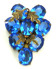 Czechslovakia blue dress clip http://www.vintagecostumejewelryaddiction.com/vcja3597.html