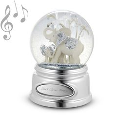 Elephants are symbols of wisdom in Asian cultures and revered for their intelligence and memories. She'll never forget how much you care about her when she reads what you engraved on this charming snow globe that features a snuggling mom and baby elephant. Both elephants shine with beaded silver detailing on their ears, while the globe rotates. https://www.thingsremembered.com/elephant-and-calf-musical-snow-globe/product/681966?fcref=pinterest&beta=1