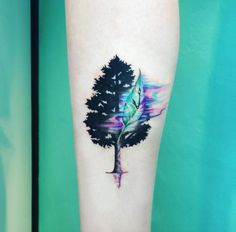 Whimsical watercolor tree tattoo