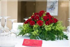 Love the table decor! The red place card takes away from the bouquet though, so maybe try it in white with black lettering and gold embellishments