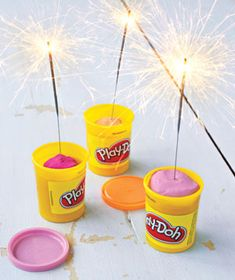 Play-Doh as Sparkler Holder  Prevent burned fingers by planting a sparkler's stem in a  tub of Play-Doh before lighting it.