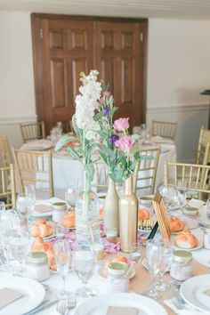 Simple floral arrangements in pretty decorative bottles. Photo credit: The Lockharts