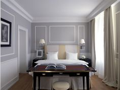 Paneling on the walls and ceiling covings adds a traditional feel to a contemporary room.