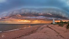 Storm cloud over the West Point Lighthouse on Prince Edward Island by Deepti Suddul