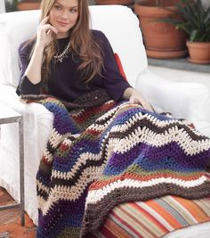 How cozy does this crochet afghan look!? Cuddle up and create this crocheted work of art!