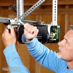 How to Rebuild a Garage Door Opener Garage door humming or grinding but doesn't open? It may be stripped gears. We'll show you an easy fix. Garage Door Bottom Seal, Garage Door Track, Garage Door Springs, Garage Door Design, Garage Door Opener Installation, Garage Door Opener Repair, Quiet Garage Door Opener, Garage Shop, Garage House