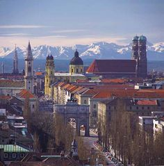 Munich, Germany - The double towers of the Frauenkirche (right) with the gorguous backdrop of the Alps.