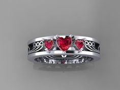 zelda inspired engagement ring made in 14 kt white gold with natural rubies the shape and color of the gems can be modified - Zelda Wedding Ring