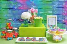 love the tie dye back drop for a sweets table / silent auction tables/ picture booth... (we can make them our selves one after noon out of old white bed sheets)