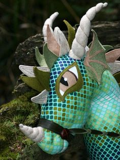 You will receive the WhimsyWoo All Fired Up Dragon PDF Pattern!  My very dearest treasure the Woooie Hobby Horse now has a medieval Cousin the All Fired Up Dragon! Create a Dragon of your very own. Instructions show include how to make they eyes out of felt. You do not need an embroidery machine to make this project. This PDF pattern allows you to sell the finished products under this agreement: * All items made using this pattern can be sold, however on tags, signage and internet listings…