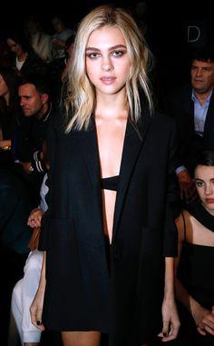 Nicola Peltz sizzles in an oversized black tuxedo jacket at the Balenciaga show.