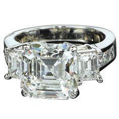 Platinum engagement ring with emerald-cut diamond center stone and side stones, Jacob & Co