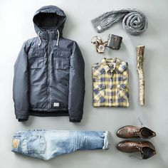 Syle your puffy jacket with a check shirt and chunky scarf for a rustic…