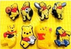 Set of 8 Winnie the Pooh Themed Backpack Buttons and Shoe Charms, Shoe Snap on Decorations, Charms, Buttons, Widgets, for Clogs, Crocs, Bracelets and More by Winnie the Pooh. $7.40. Set of 8 Winnie the Pooh shoe charms. This great assortment is for childrens and adults. Give your Crocs, Clogs and similar Shoes your own individual Look. Press the holder of the Shoe Charms with a slight twist in the holes of the shoes.