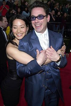 "Watson and Holmes!  Lucy Liu (now playing Watson on CBS's ""Elementary"") and Robert Downey Jr. (now playing Holmes in the ""Sherlock Holmes"" movie franchise) were castmates in ""Ally McBeal"" - pictured here at the 2001 SAG Awards."