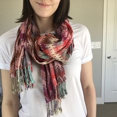 Anthropologie Knit Scarf This stretchy scarf from Anthropologie is super soft and snuggly. Made of 100% viscose. Colors  are warm with reds, pinks, purples, cream and a hint of green and blue. Great condition! Dry clean only. Anthropologie Accessories Scarves & Wraps