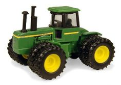 1:64 John Deere 8430 Vintage Tractor by ERTL. $7.99. From the Manufacturer                This 1/64 4 wheel drive tractor is great size for the little farmer's hands. The sturdy die cast construction stands up to the rough, rugged play in the sand box.                                    Product Description                This 1/64 4 wheel drive tractor is great size for the little farmer's hands. The sturdy die cast construction stands up to the rough, rugged play in the sa...