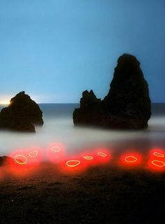 """Landscapes Abstracted: Barry Underwood, an artist and professor of photograpy at the Cleveland Art Institute, is doing wild things with lights and landscapes. Temporarily installing his lights in American forests, hills, meadows, and riverbanks, Underwood explores the """"potential of the ordinary."""""""
