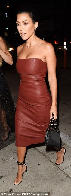 Classic beauty: Again ensuring her dress took centre stage, Kourtney kept her hair and makeup minimalistic