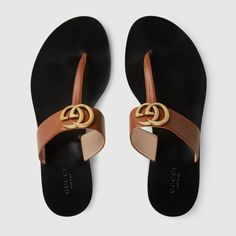 Leather thong sandal with Double G - Gucci Shoes - Latest and fashionable gucci shoes - Shop the Leather thong sandal with Double G by Gucci. The leather thong sandal is embellished with the Double G hardwarean archival design from the Sandals Outfit, Sport Sandals, Sandalias Teva, Baskets, Stylish Sunglasses, Designer Sandals, Gucci Shoes, Chanel Sandals, Luxury Shoes