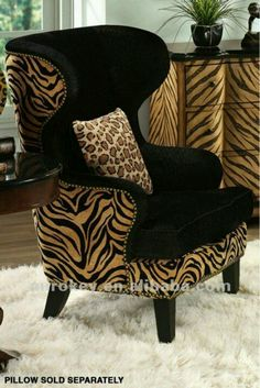Home Furnishings: Animal-print wing chair and chest. Animal Print Furniture, Animal Print Decor, Animal Prints, Wingback Chair, Armchair, Chair Pillow, Chair Cushions, Safari Bedroom, Funky Furniture