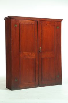 Shaker Cupboard Lebanon, New York Mid 19th Century Cherry and Poplar.  Dovetailed case, two paneled doors and a good old finish  Garths