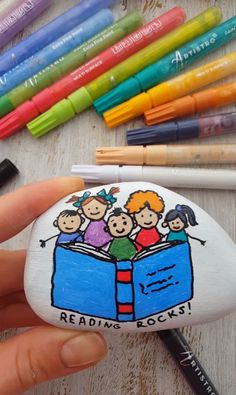 Poetry day rock painting - Video tutorial Artistro acrylic paint pens Read a book day. Rock painting ideas, pebble painting, r - Pebble Painting, Pebble Art, Stone Painting, Stone Crafts, Rock Crafts, Paint Pens For Rocks, Niedlicher Panda, Poetry Day, Dark Poetry