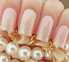 Pale pink and sparkles nails