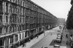 High angle view of a row of apartment buildings along a street in the Bronx, New York, New York, 1950s.