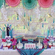 Iridescent streamers and twinkle lights backdrop