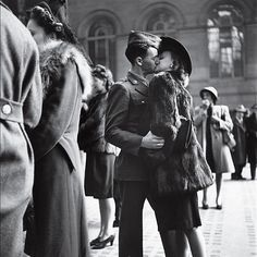 INK361 - Photo - In 1944, LIFE's Alfred Eisenstaedt captured a private moment repeated in public millions of times over the course of the war: a guy, a girl, a goodbye — and no assurance that he'll make it back. By war's end, more than 400,000 American troops had been killed. (Alfred Eisenstaedt —Time & Life Pictures/Getty Images)
