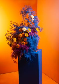 An arrangement inspired by the colours and textures of Danish designer Verner Panton's work. #LFS #floristrycourse #paintedflowers #flowerarrangements