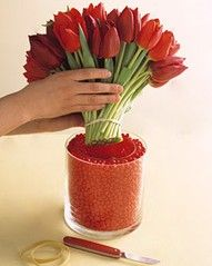 a vase within a vase (i'm thinking red hots would be perfect for a valentine centerpiece) ♥
